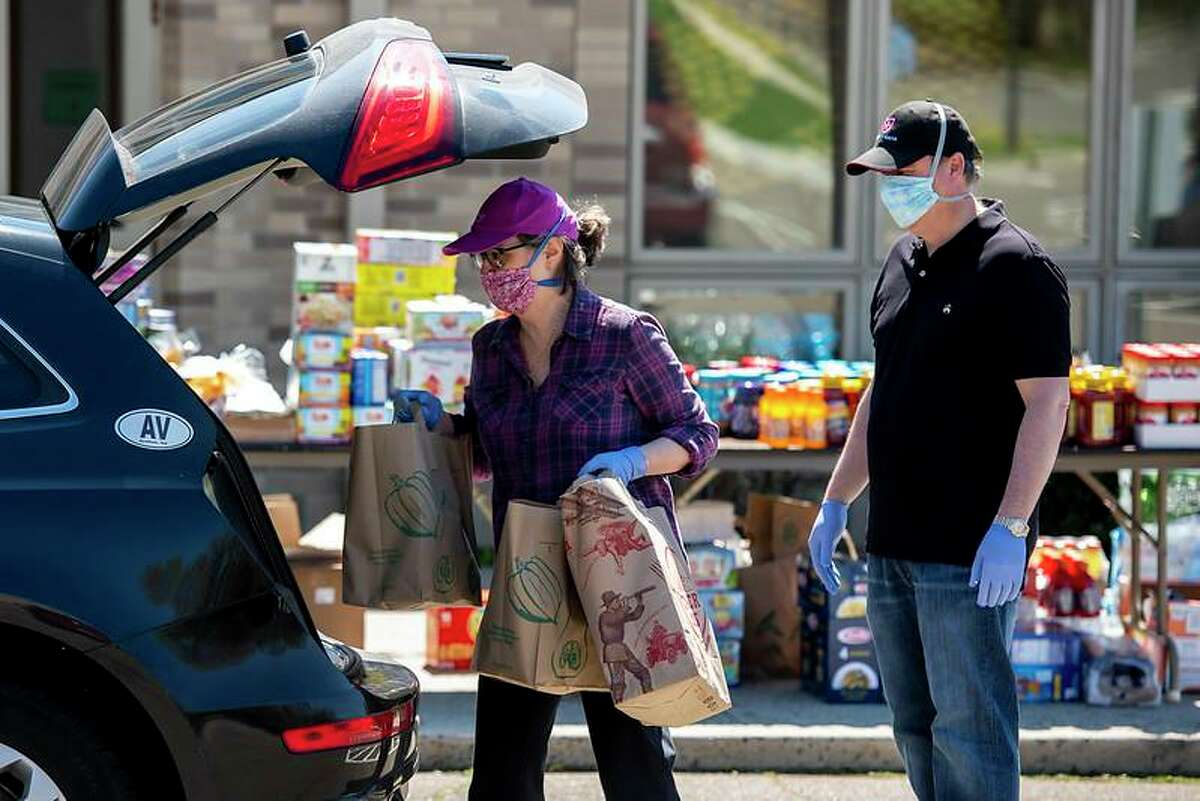 The Parish of St. Catherine of Siena held a Drive Through Food Drive to support local food pantries on May 2. More than 150 cars came through and more than $3,000 in cash donations and food donations overflowed from nearly 100 feet of tables.