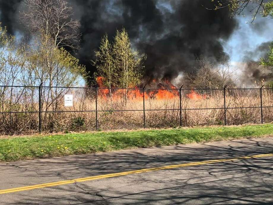 A view of Sunday's brush fire at Tweed New Haven Regional Airport. Photo: New Haven Fire Department / Chris Gagliardi