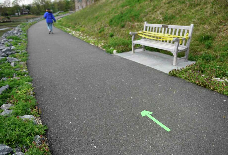 An arrow indicates which direction to walk at the newly re-opened Cos Cob Park in the Cos Cob section of Greenwich, Conn. Monday, May 4, 2020. Photo: Tyler Sizemore / Hearst Connecticut Media / Greenwich Time