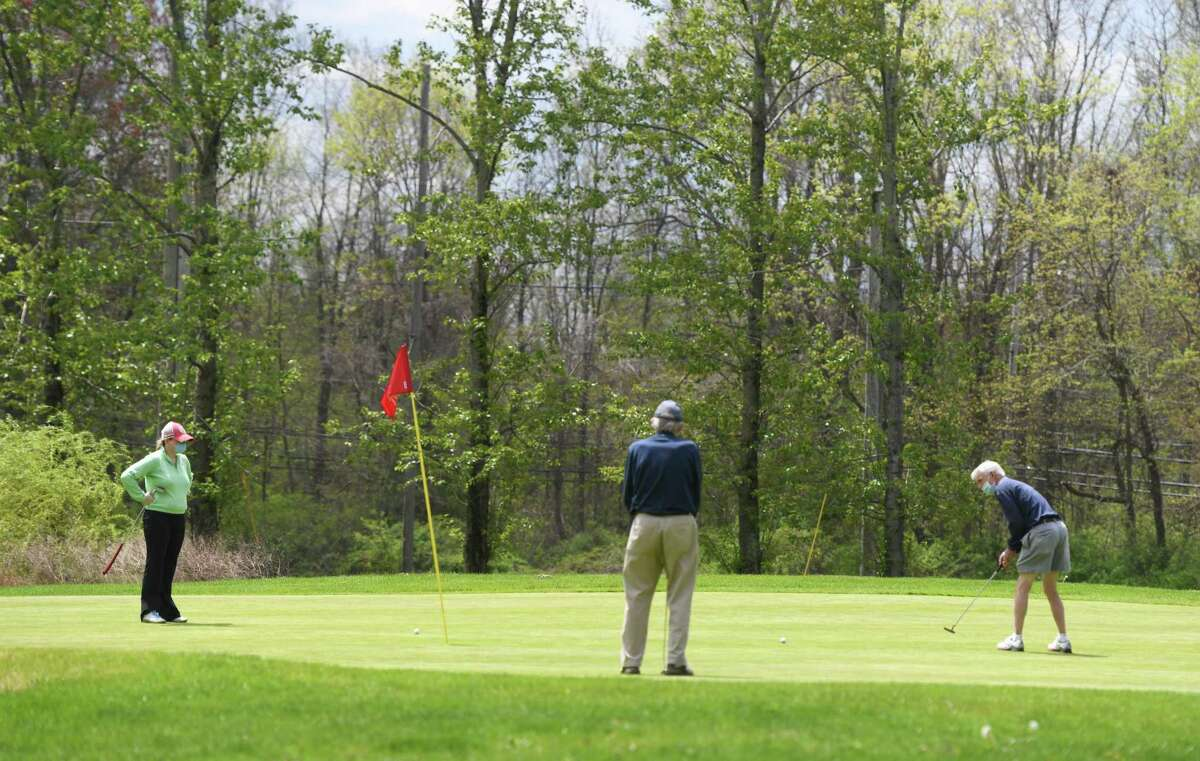 Golfers hit the links at the newly re-opened Griffith E. Harris Golf Course in Greenwich, Conn. Monday, May 4, 2020.