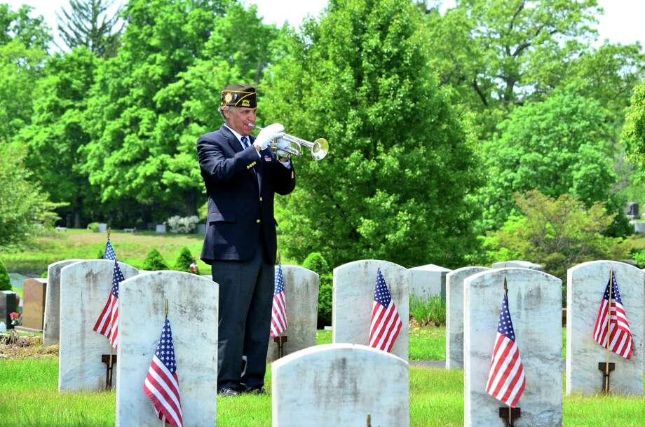 Anthony Montimurro of the Darien VFW and Buglers Across America played taps at the end of the Memorial Day ceremony on Monday, May 26 . Photo: Megan Spicer / Megan Spicer / Darien News