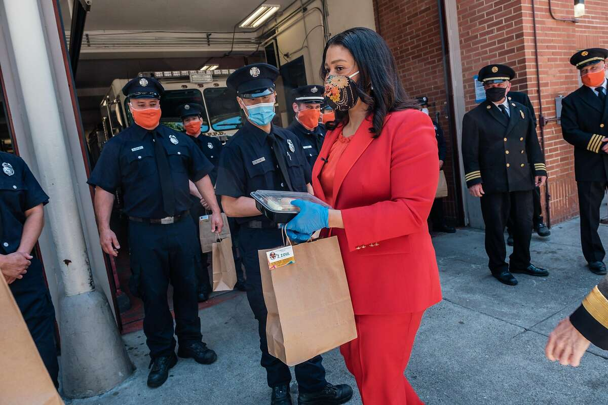 Mayor London Breed distributes meals from Z Zoul Sudanese Cafe to firefighters and paramedics at Fire station 6 as part of International Firefighters Day. in San Francisco, Calif. on Monday, May 4, 2020.