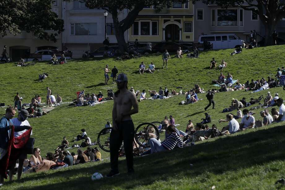 People relax at Dolores Park in San Francisco on Sunday, May 3, 2020, during the coronavirus outbreak. Photo: Jeff Chiu/Associated Press / Copyright 2020 The Associated Press. All rights reserved