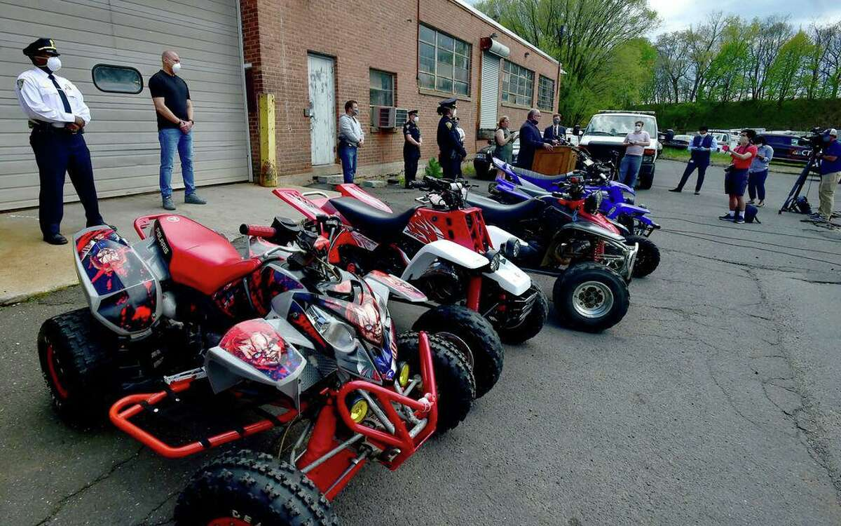 In this file photo, Assistant Chief Karl Jacobson speaks at podium, right, during a New Haven Police Department press conference at the New Haven Police Department Garage Monday announcing all terrain vehicle and dirt bike enforcement and recent arrests of ATV and dirt bike riders in New Haven on May 4, 2020.