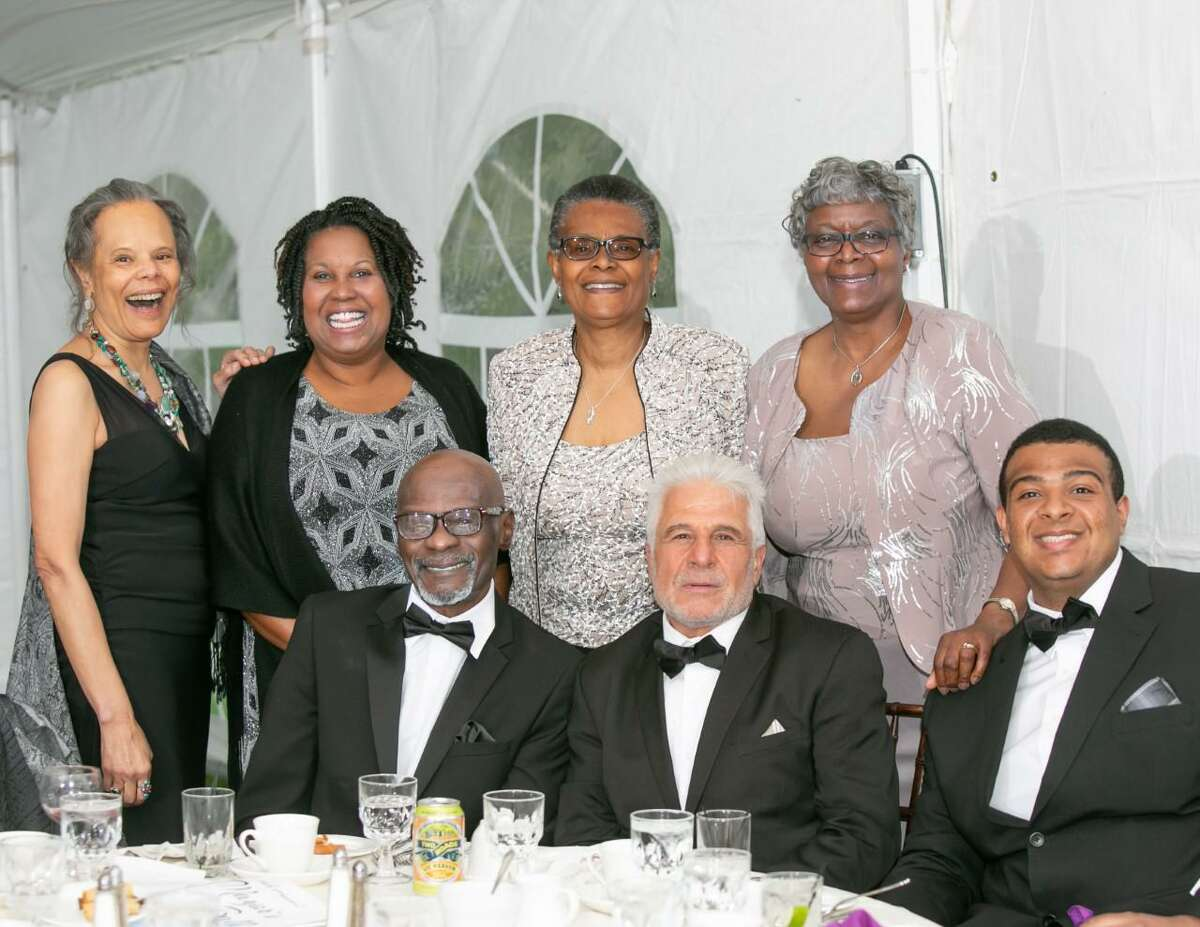 A group of friends and family of the late Louis Petruzzello of Middletown (seated, center) are shown on the occasion of his wife, Deborah Petruzzello's (at top right, in purple) mayor's ball in past years. The longtime track coach won the Community Service Award. Their son Tony is at far right.