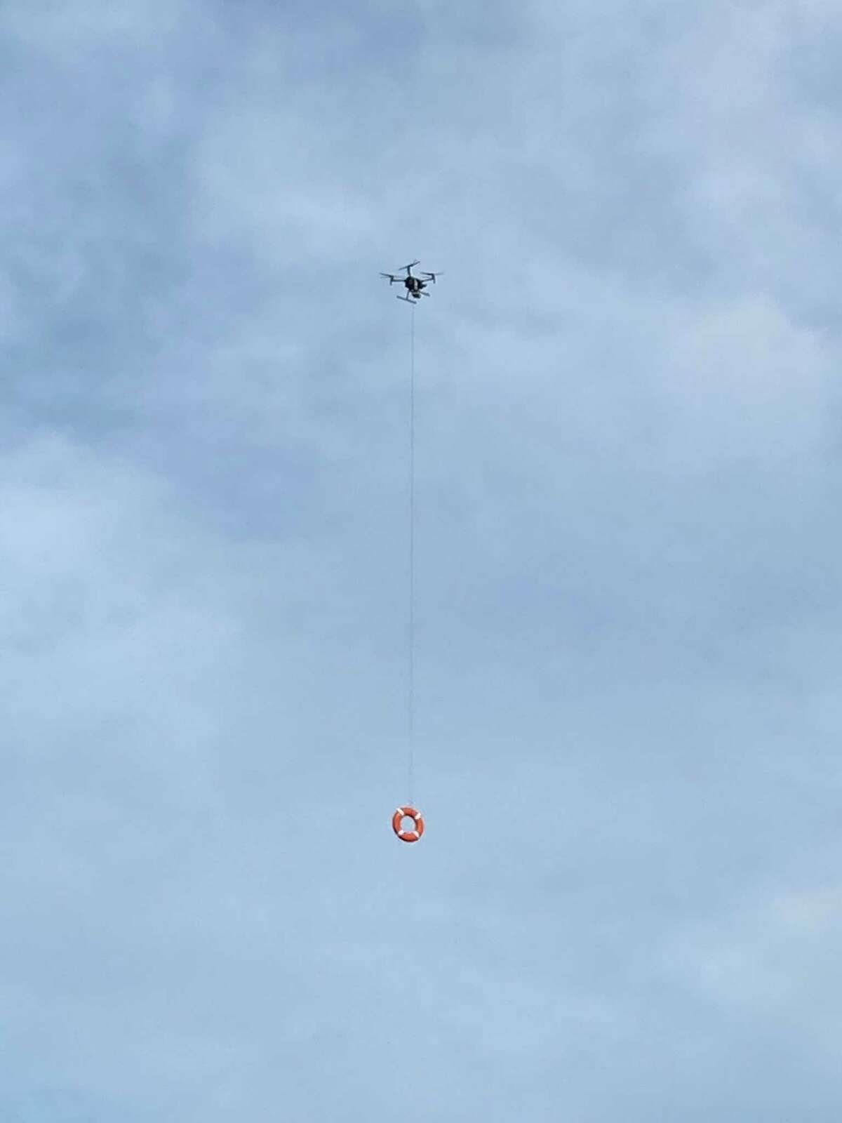 The Fairfield Police Department practicing using a drone to deploy personal floatation devices to struggling swimmers.