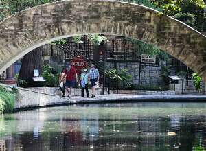 A few people ventured out on the River Walk on Monday, after the weekslong statewide shutdown was lifted..
