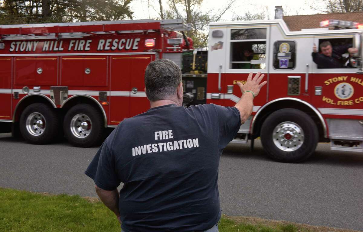 Brookfield Fire Chief Wayne Gravius, who is stepping down as chief, was thanked for his years of service with a parade of first responders on Monday night. Members of Brookfield Volunteer Fire Department teamed up with other area fire departments and first responders to drive by his home. Monday, April 4, 2020, in Brookfield, Conn.