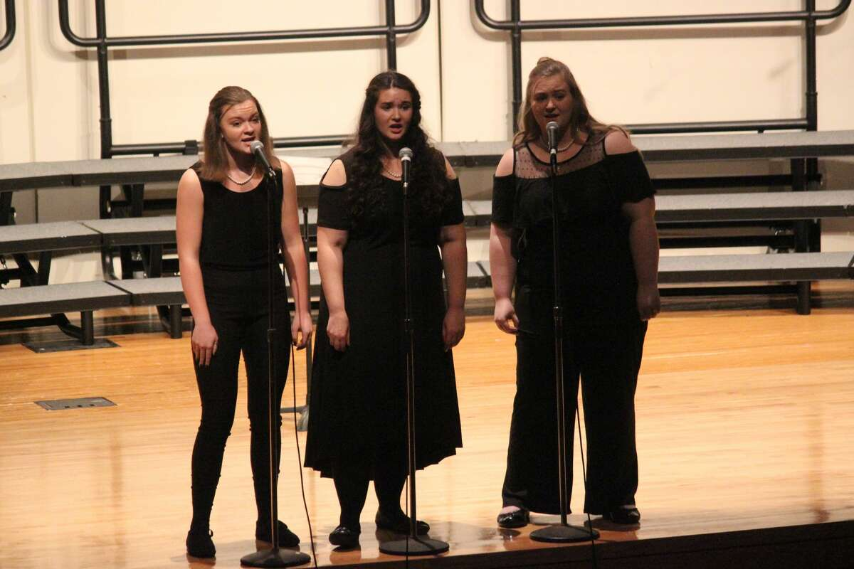 Seniors Melia Lorenz, Emily Barron and Hailey Fiel perform during the 2019 holiday concert.