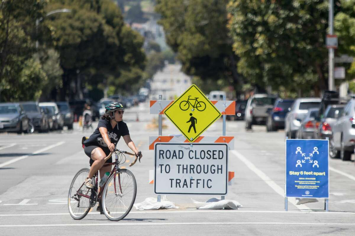 A bicyclist rides their bike down Lake Street, one of the designated Slow Streets in San Francisco on May 4, 2020.