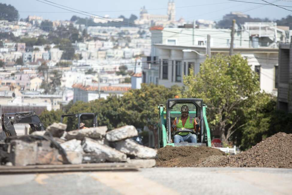 Construction Status: permitted to operate statewide per county health rules Construction across the state is mostly open and the Bay Area recently gave the green light for projects to resume on May 4 if certain physical distancing measures are in place. In this photo, a construction worker works on a street project in San Francisco on May 4, 2020. The state released guidance for the construction industry to create a safe environment for workers.