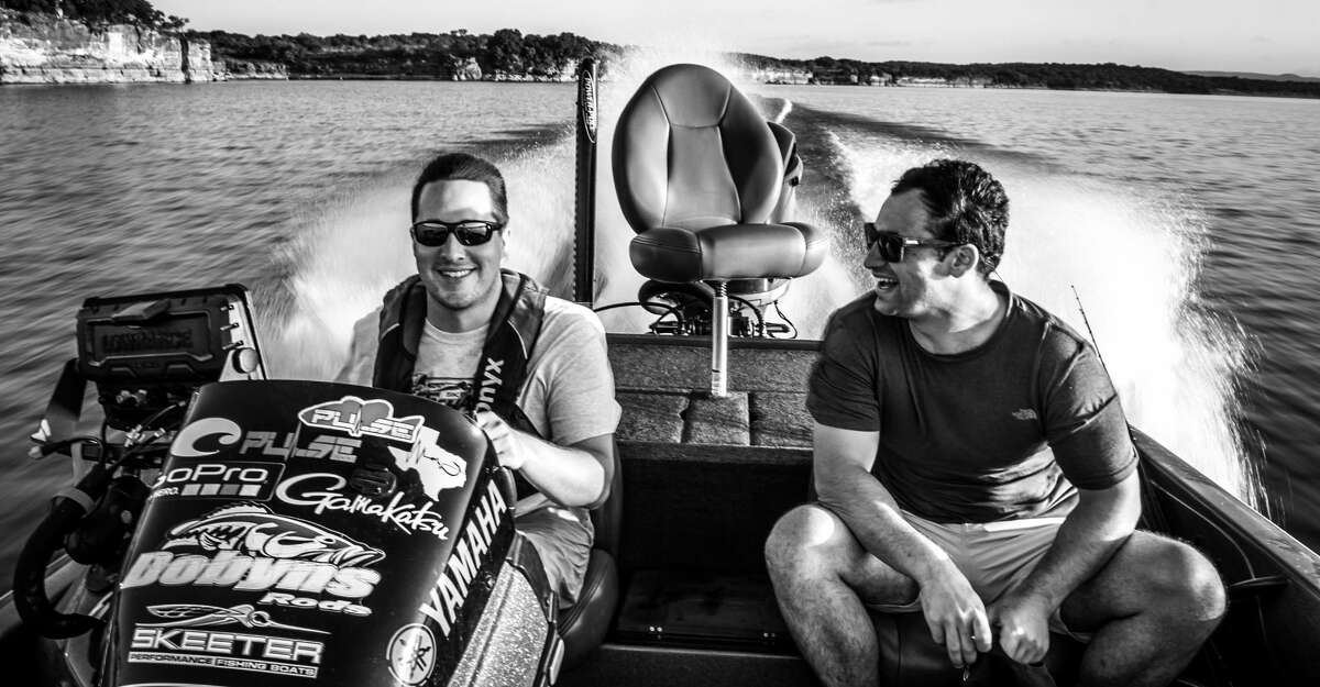 Guide Jake Kennamer of Uncharted Fishing with Captain Experiences founder and CEO Jonathan Newar on Lake Travis.
