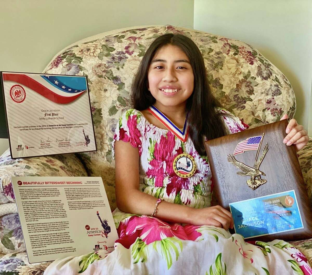 Grace Jacobson, an eighth grader at Trinity Lutheran School, poses with her many awards she earned as a winner of the Farm Bureau Insurance Company America and Me contest. Jacobson placed sixth out of 3,500 entrants from 350 schools.Among herawards was a $1,000 check. (Submitted photo)