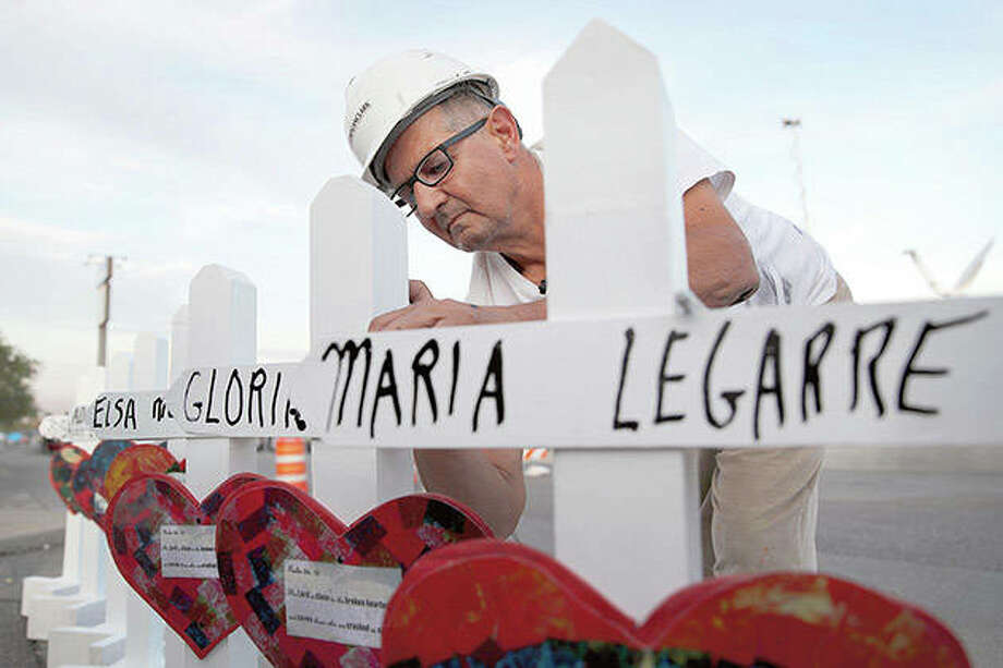Greg Zanis of Aurora prepares crosses in August to place at a makeshift memorial for victims of a mass shooting at a shopping complex in El Paso, Texas. Zanis has died after a struggle against bladder cancer. Photo: John Locher | AP
