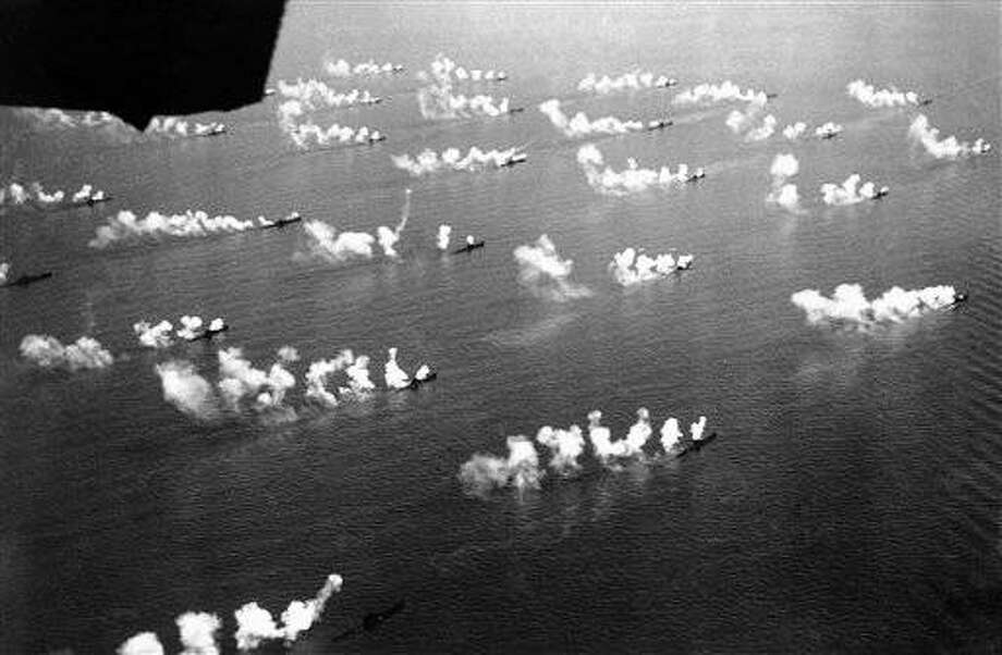 Ninety Italian submarines forming a moving quadrilateral of nine columns, submerged simultaneously, surfaced fired a salvo, and submerged again all as one united. View of lines of submarines in the bay of Naples, Italy on May 5, 1938, taking part in manoeuvres watched by German Chancellor Adolf Hitler and Italian dictator Benito Mussolini. (AP Photo)