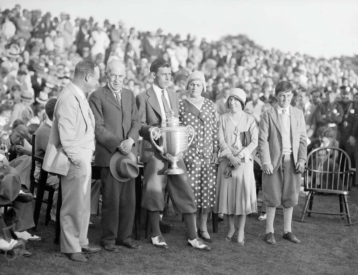 Tom Creavy, a 20-year-old golfing sensation from Albany, after being presented with Professional Golfing Association Cup by P.G.A. President Charles Hall on Sept. 19, 1931. Group includes Creavy, Hall, Creavy's mother, father, his sister and his caddy. --- Image by © Bettmann/CORBIS