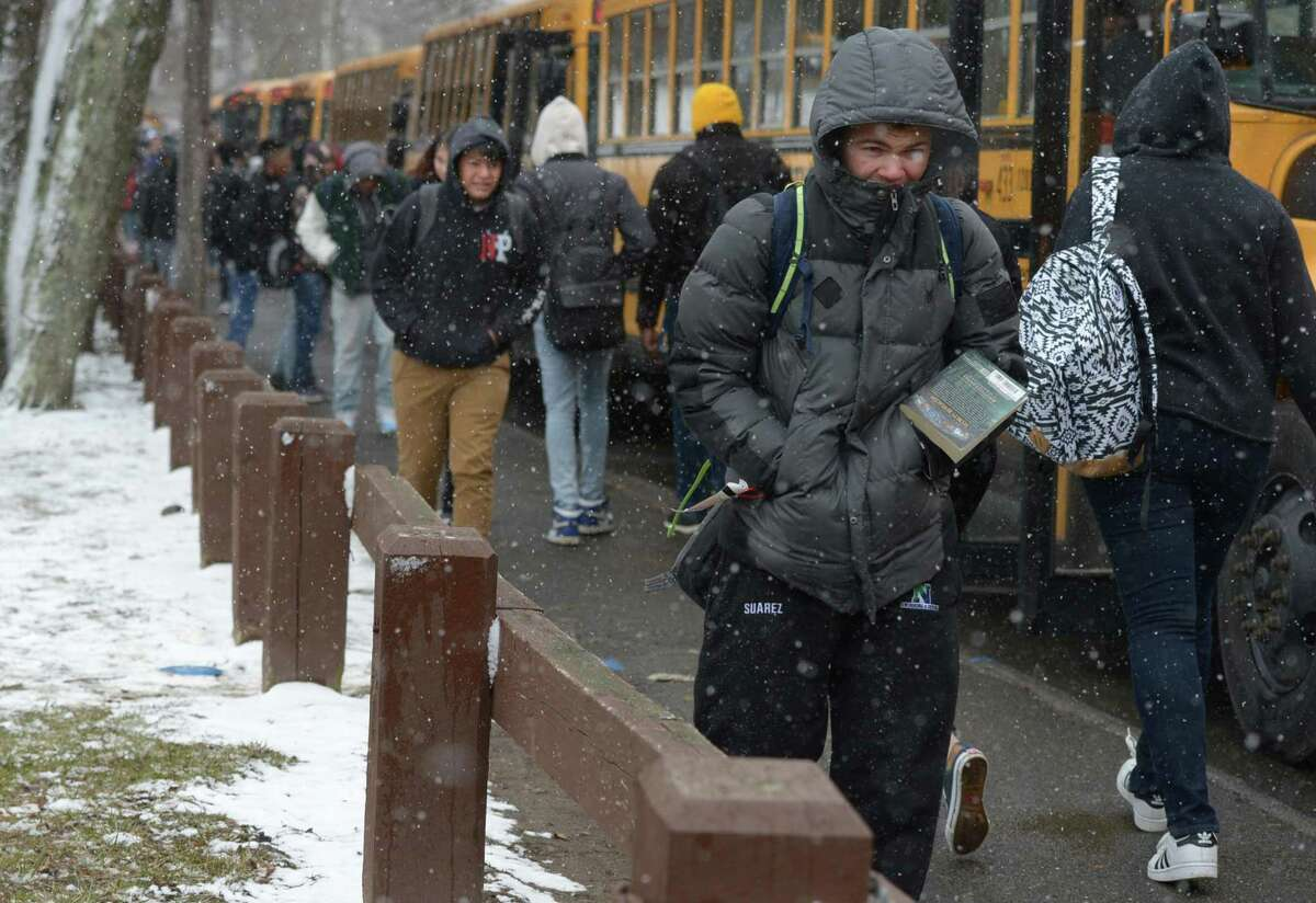 Norwalk High School students are dismissed early due to the 4th Nor'Easter this year Wednesday, March 21, 2018, in Norwalk, Conn. Accumulations came to close to an inch by 2pm.