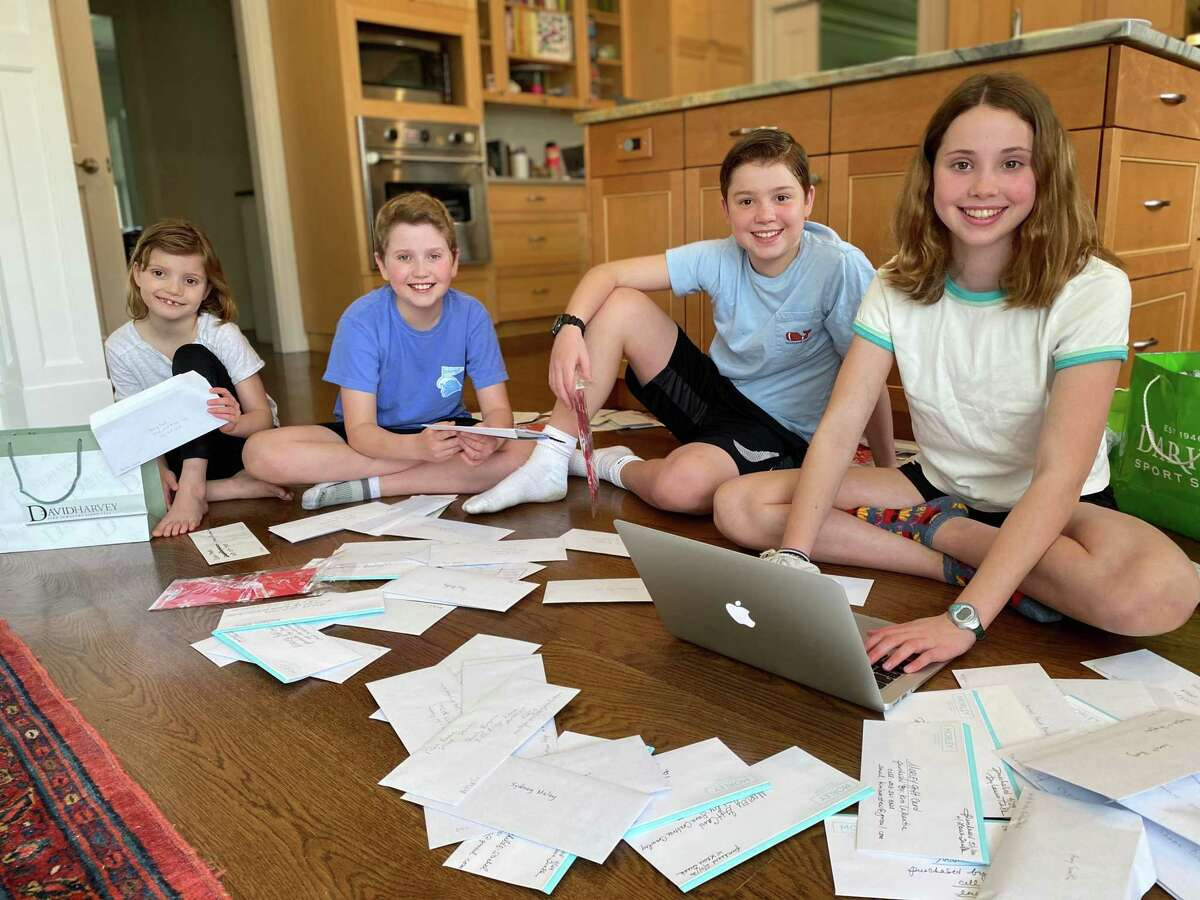 Fourteen-year-old Sophie Curtis, who is a freshman at Darien High School, and her three siblings - Ben, 12; Will, 10, and Grace, 7 - work on a project they created called Rescue Main Street Darien.