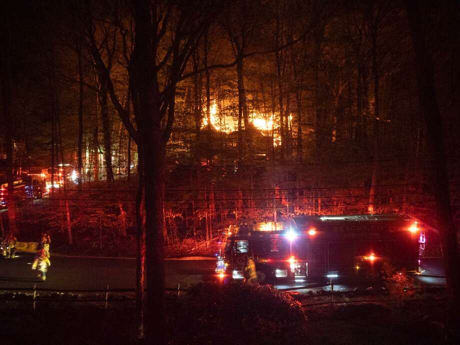 Firefighters battling a blaze on Blackwood Lane that was called in just after midnight on Tuesday morning. No one was home when the fire started and no one was injured, officials say. the three bedroom home was completely destroyed. Photo: Steve Labkoff / Contributed