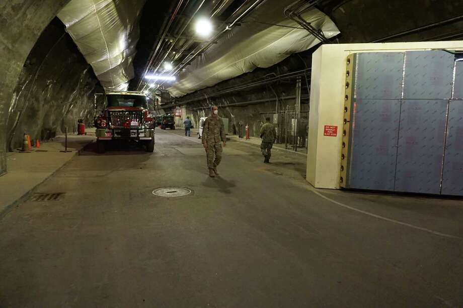 U.S. military personnel work at Cheyenne Mountain, a Cold War-era facility built into a Colorado mountain, where a team of about 130 service members cloistered from their families and the broader military community are now operating an air defense and watch mission for North American Aerospace Defense Command (NORAD). Photo: NORAD/U.S. Northern Command Photo / Handout