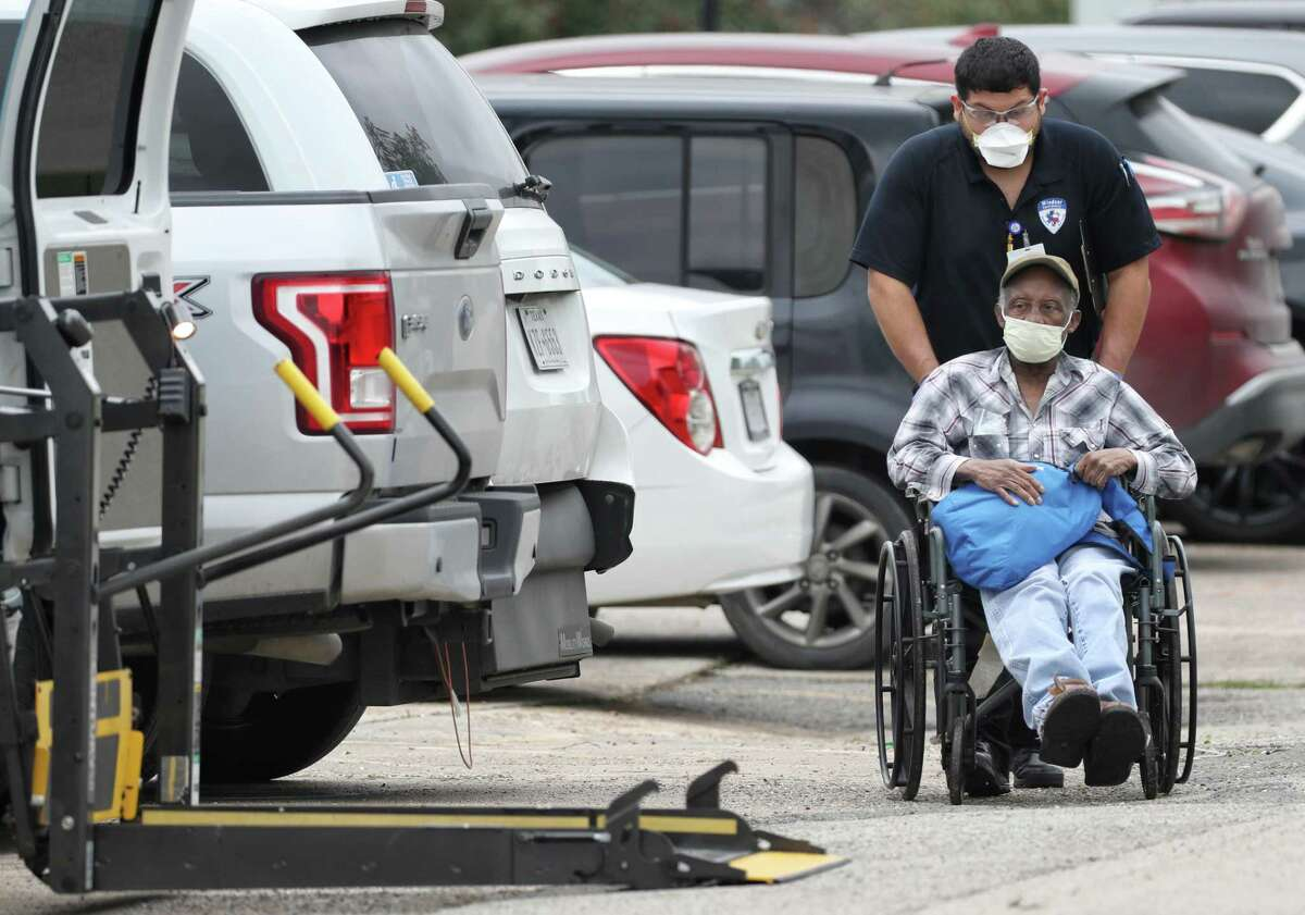 A person is loaded into an ambulance as he leaves the La Porte Healthcare Center on Wednesday, April 8, 2020, in La Porte. A COVID-19 outbreak at the assisted living facility has infected 34 residents and staff so far, Harris County Public Health announced Tuesday.