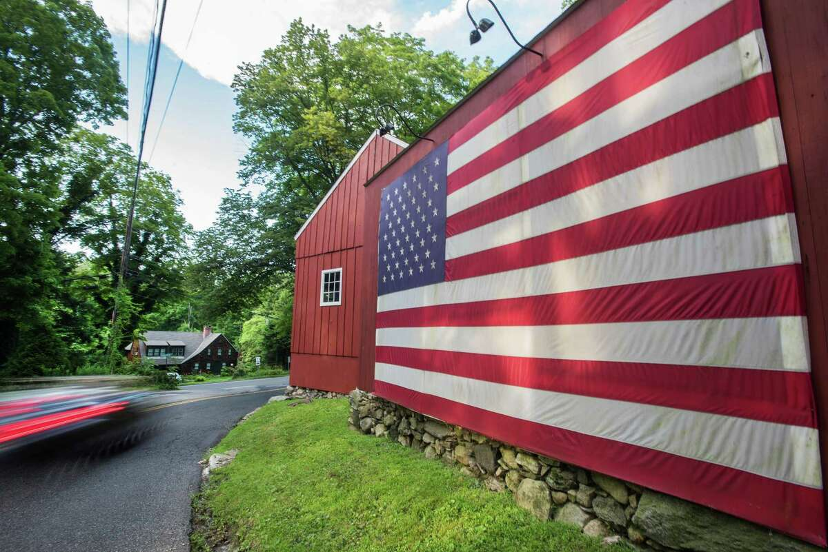 This flag on Belden Hill Road in Wilton last year was a reminder of reminder Independence Day in Wilton and a day of town-wide celebration.
