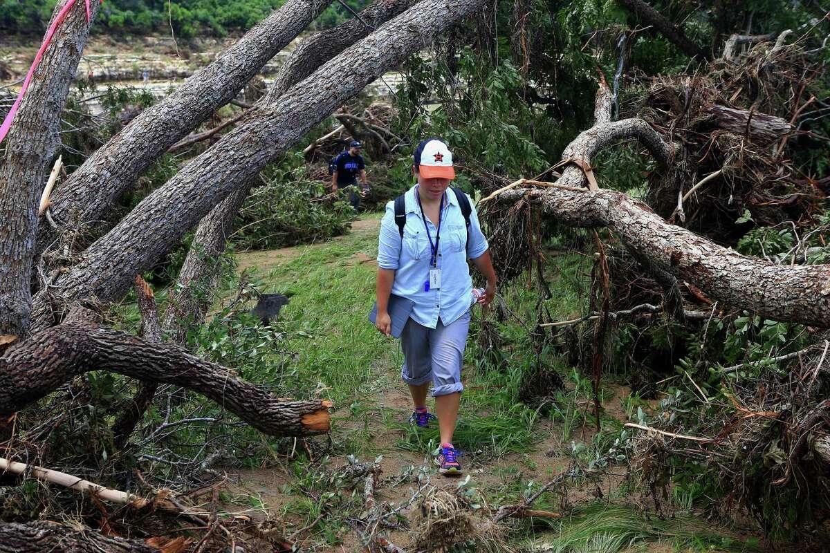 Julie Garcia walks through flood devastation in Wimberley, while reporting on the devastation in May 2015.