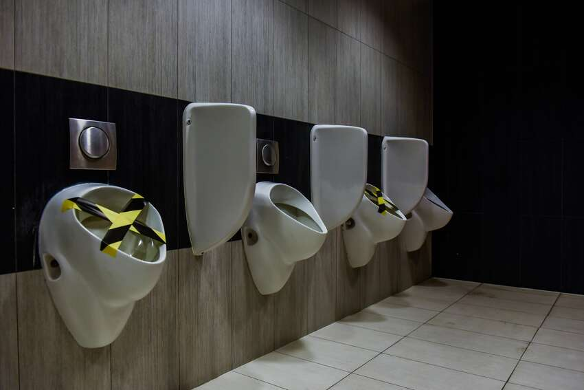Socially distant bathroom breaks? Those could be in your future too. Here, every other urinal in the Bonarka shopping mall in Krakow, Poland is taped off, preventing people from getting too close when nature calls.