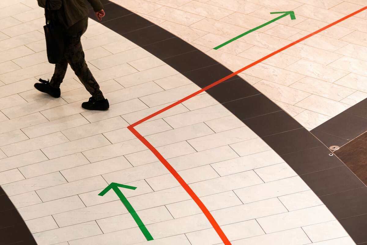 When some malls opened in Dresden, Germany, green arrows and red lines were added to the floor to encourage safe physical distancing.