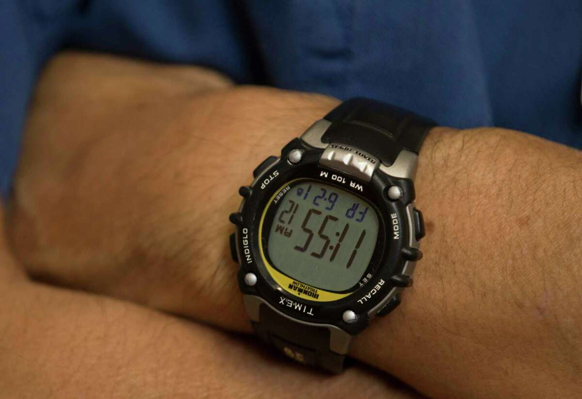 Dr. Ken Fujise, 58, poses for a photograph at the University of Texas Medical Branch Health Heart Station and Cardiac Catheterization Lab operation room on Friday, June 21, 2019, in Galveston. Dr. Fujise, a cardiologist at TUMB, wears a Timex watch to time his early morning swimming workouts.