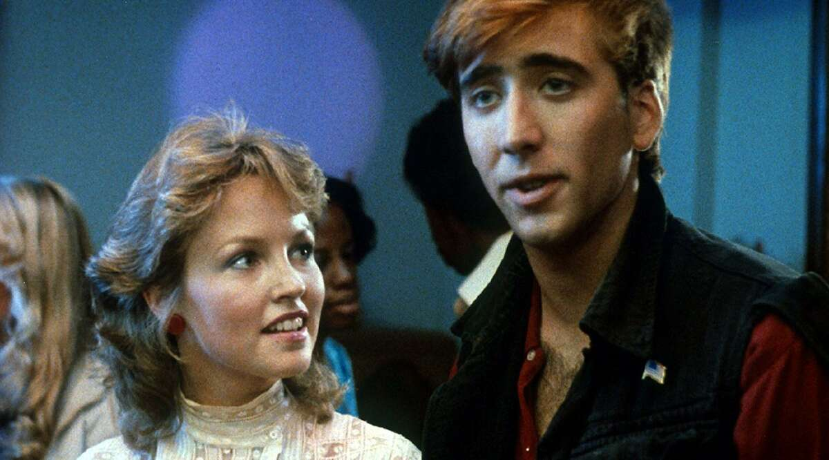 Deborah Foreman and Nicolas Cage play an unlikely couple in