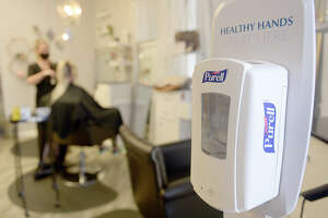 "VACAVILLE, CA - APRIL 30: A hand sanitizer dispenser placed near the entrance of Hairendipity Salon in Vacaville, California on Thursday April 30, 2020. Salon owner, Lia Rivera has re-opened her downtown after being shut down for the past month-and-a-half due to the shelter-at-home order.""(Photo by Joel Rosenbaum/MediaNews Group/Vacaville Reporter via Getty Images)"