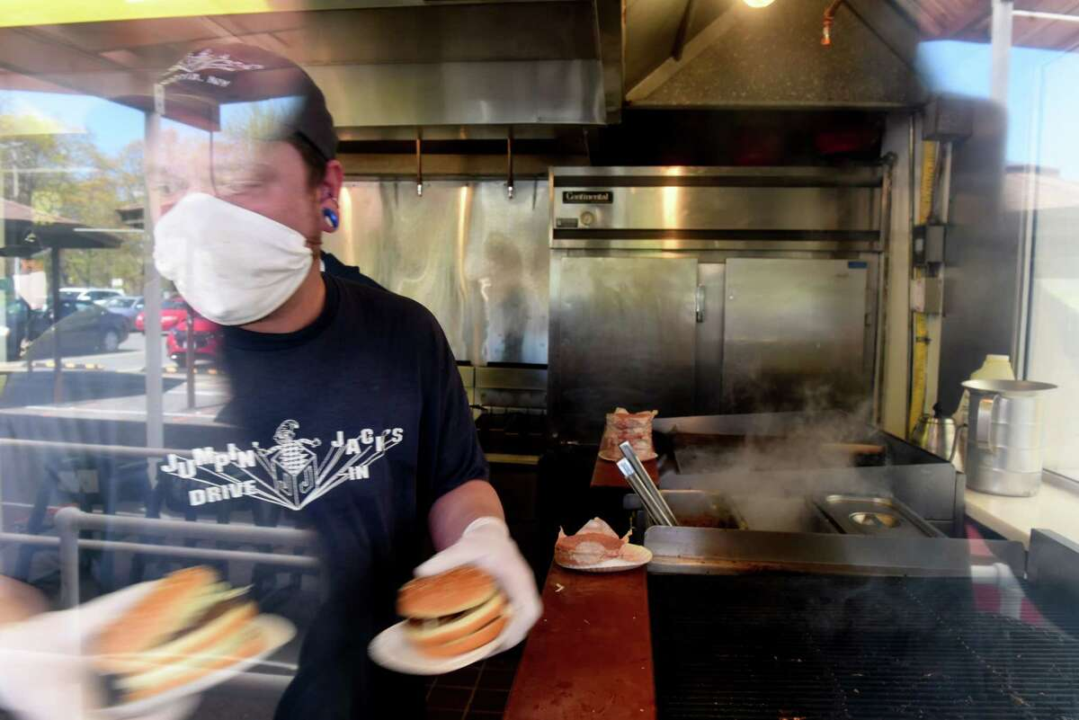Hamburgers are prepared for pickup during the opening day for Jumpin' Jack's Drive-in on Tuesday, May, 5, 2020, in Albany, N.Y. The famed local eatery is currently only taking orders by phone for curbside pickup during the coronavirus lockdown. Customers are asked to remain in their cars, and bathrooms are closed. They're open 11a.m. - 8.p.m. daily, according to their website. (Will Waldron/Times Union)