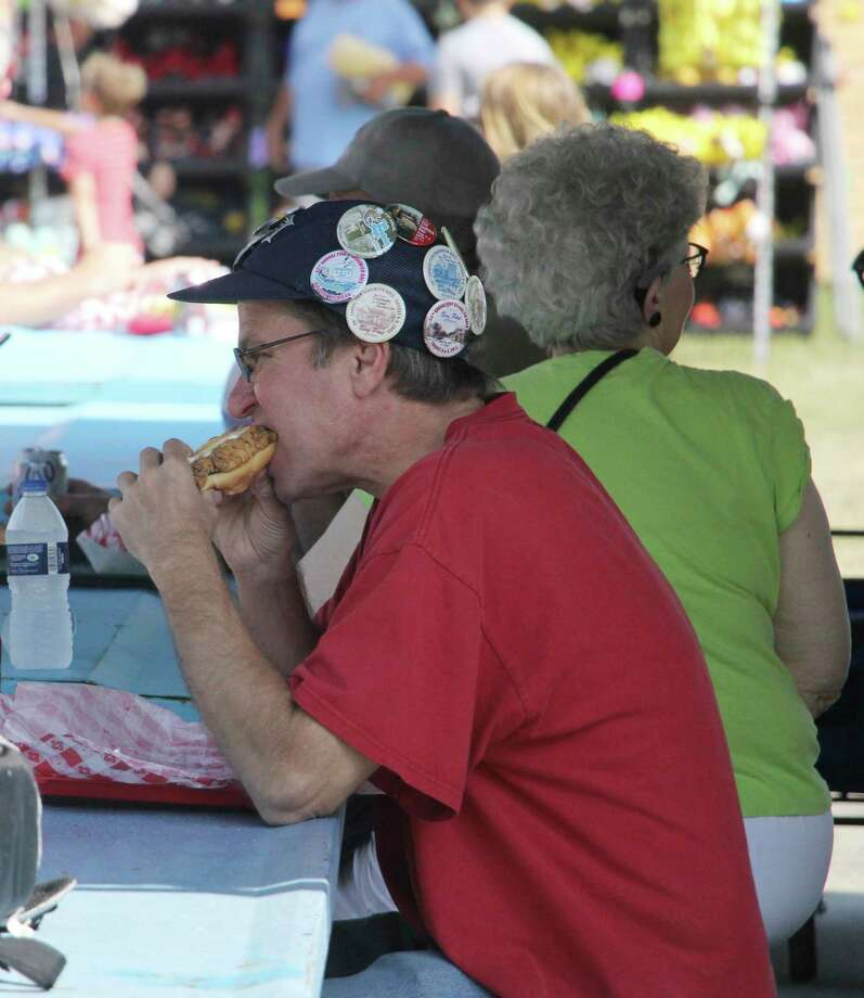An attendee at the 2019 Bay Port Fish Sandwich festival enjoys the signature dish. This year's event has been canceled due to concerns over the coronavirus pandemic. (Tribune File Photo)