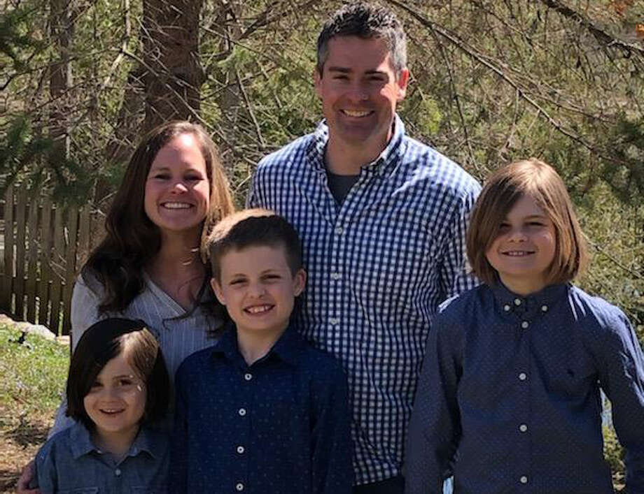 Melissa Dyste (née Worsley) poses with husband Sam and sons (from left) Clyde, Larsen, and Benjamin in a recent family photo. Photo: Photo Provided