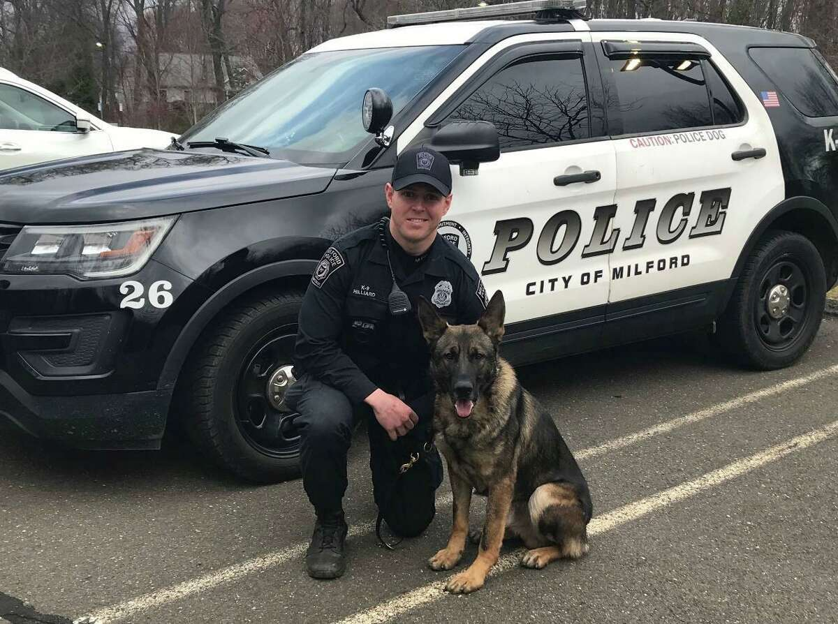 Milford Police Officer Kevin Hilliard with K9 Tyson.