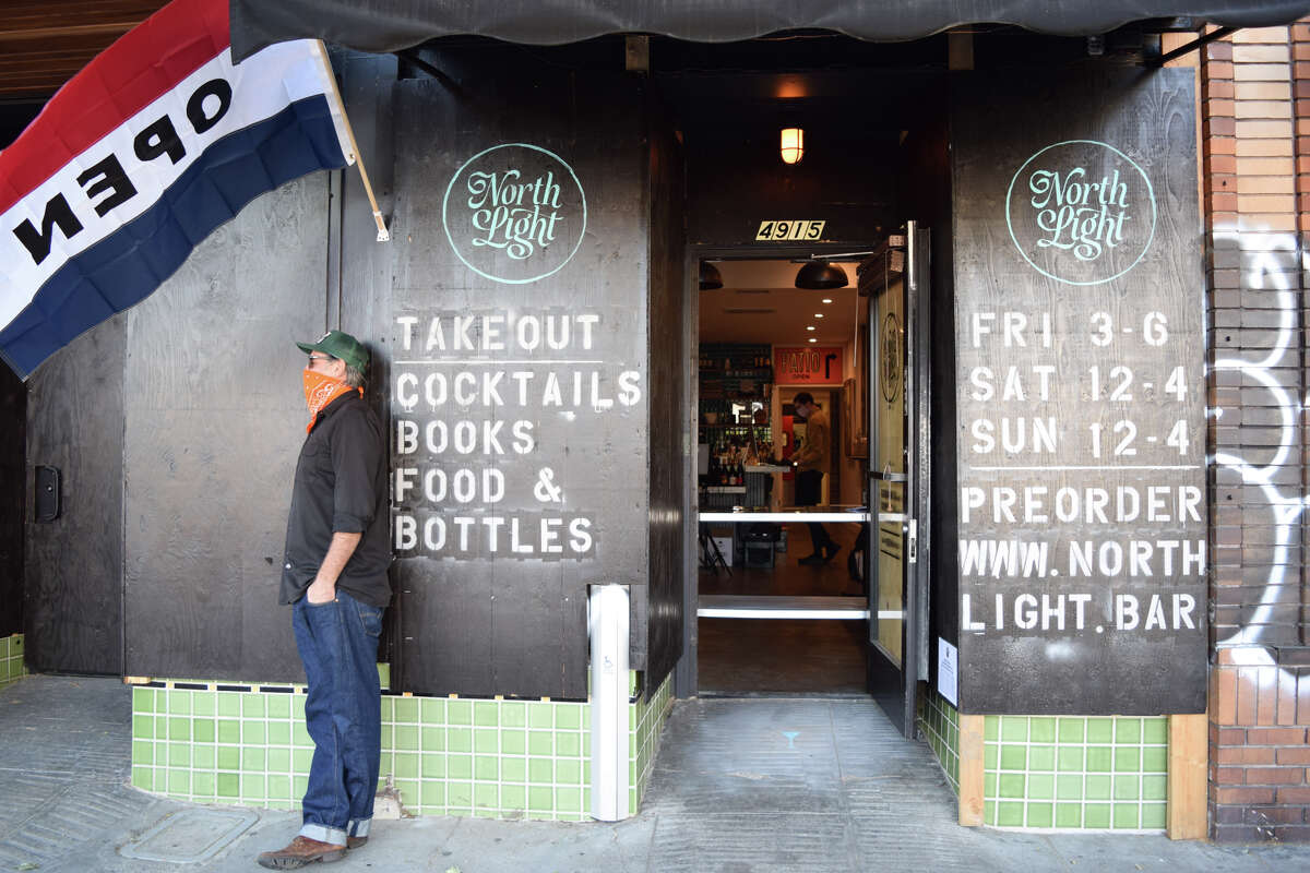 Co-owner Dan Stone stands outside the newly reopened North Light on Friday, May 1, the Oakland bar's first day of offering takeout.