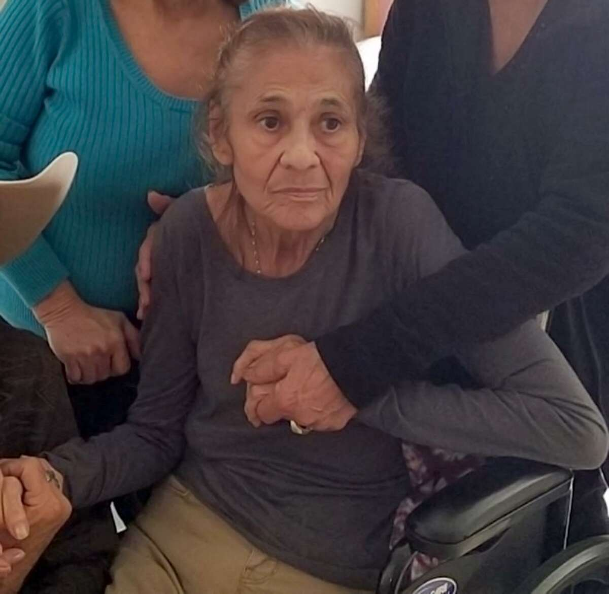 Family members surround Dolores Gutierrez DeLeon in this undated photo. DeLeon died April 23 at the age of 78. Her family has filed a lawsuit against Castillo Mission Funeral Home, alleging DeLeon's body went missing. The family's attorney said Wednesday it appears she was cremated under the name of another woman who died hte same day.