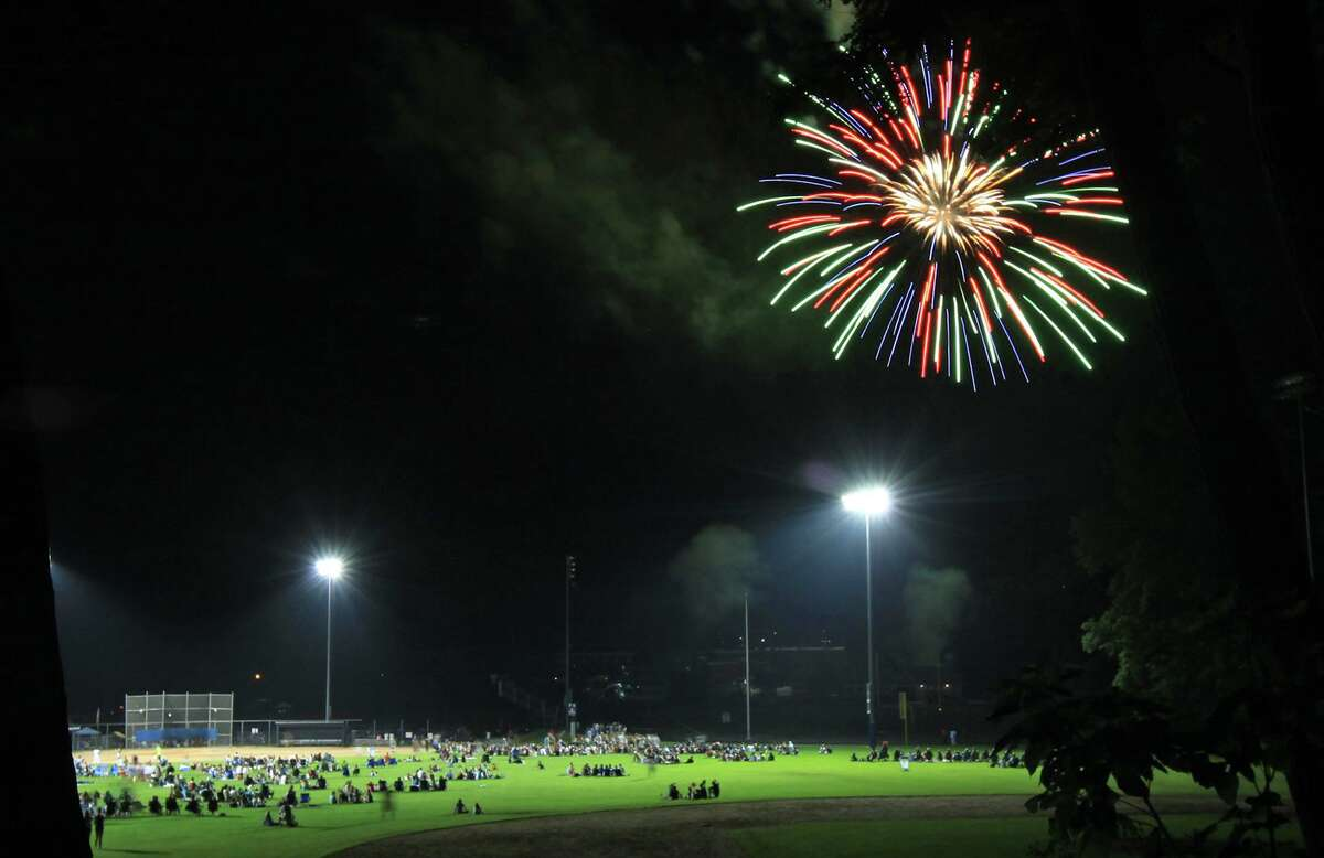 Wilton's annual July 4 celebration has been canceled this year. Pictured: Fireworks over the crowd at Wilton High School on July 4, 2013.