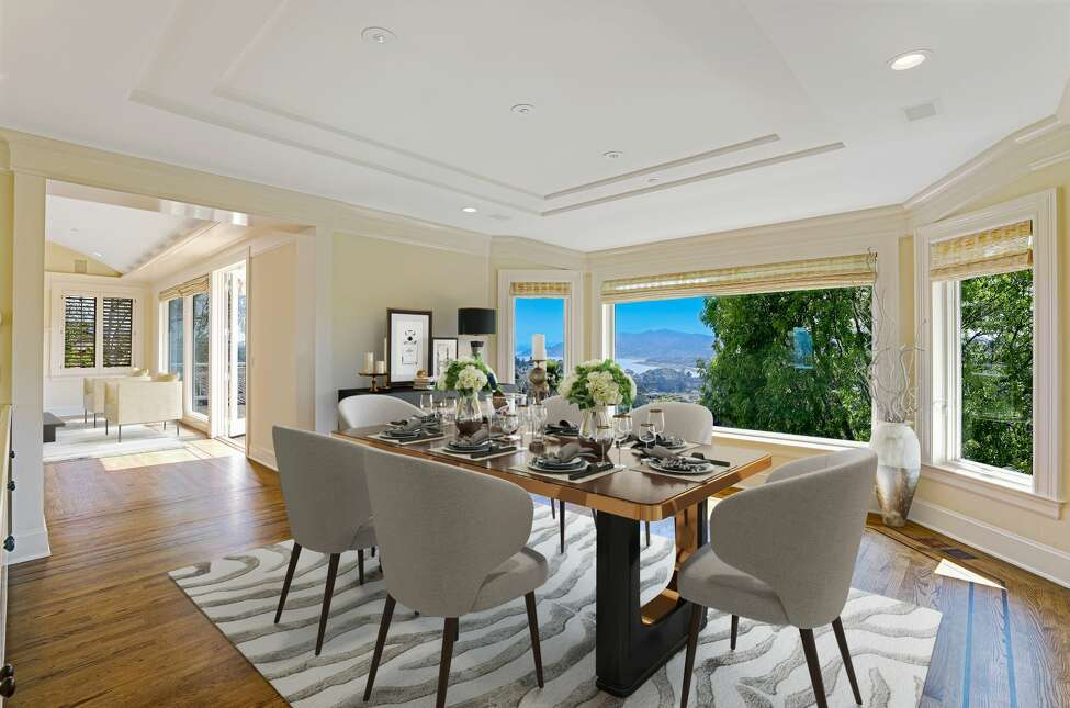 A formal dining room offers postcard views.