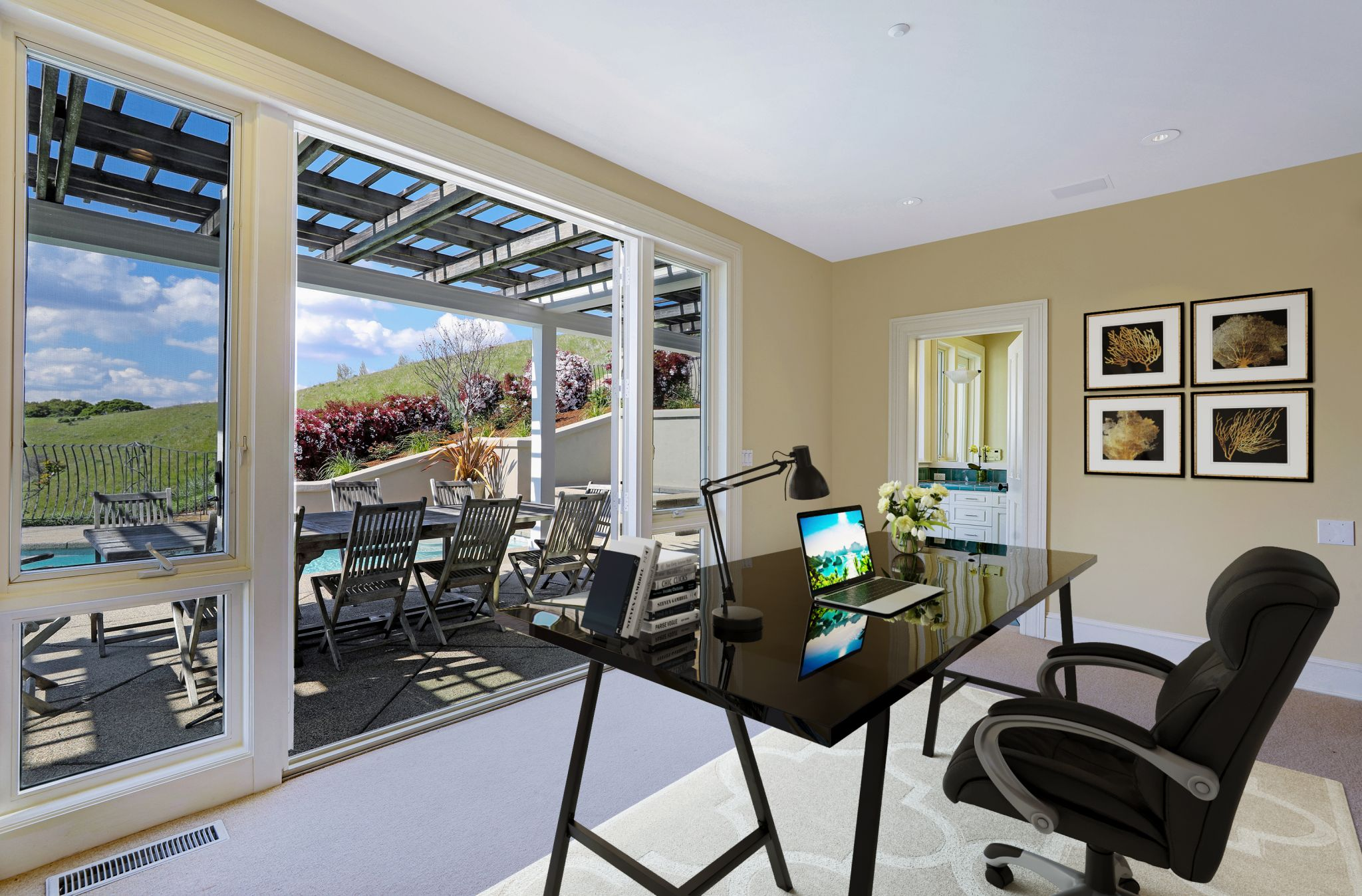 The home features an office with pool view as well as the stunning surroundings beyond.