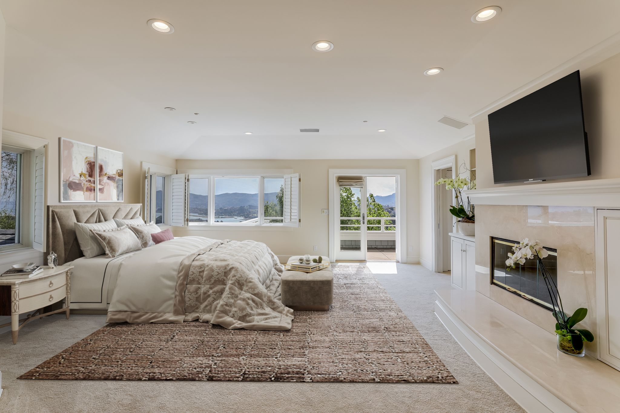 The master suite has a fireplace, a deck and huge walk-in closets.