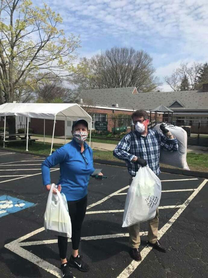 First Selectwoman Brenda Kupchick helping at the food drive on April 3. Photo: Contributed Photo / Alexis Harrison