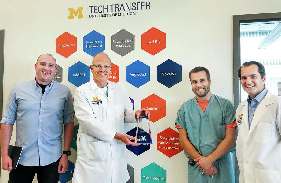 From left, MakeMedical co-founders Owen Tien, Dr. Glenn Green, Dr. Kyle VanKoevering and Dr. David Zopf pose for a photo. The group has developed a ventilator splitting device which can be used when ventilators are in short supply - an initiative that was spurred by the coronavirus pandemic. (Photo provided)