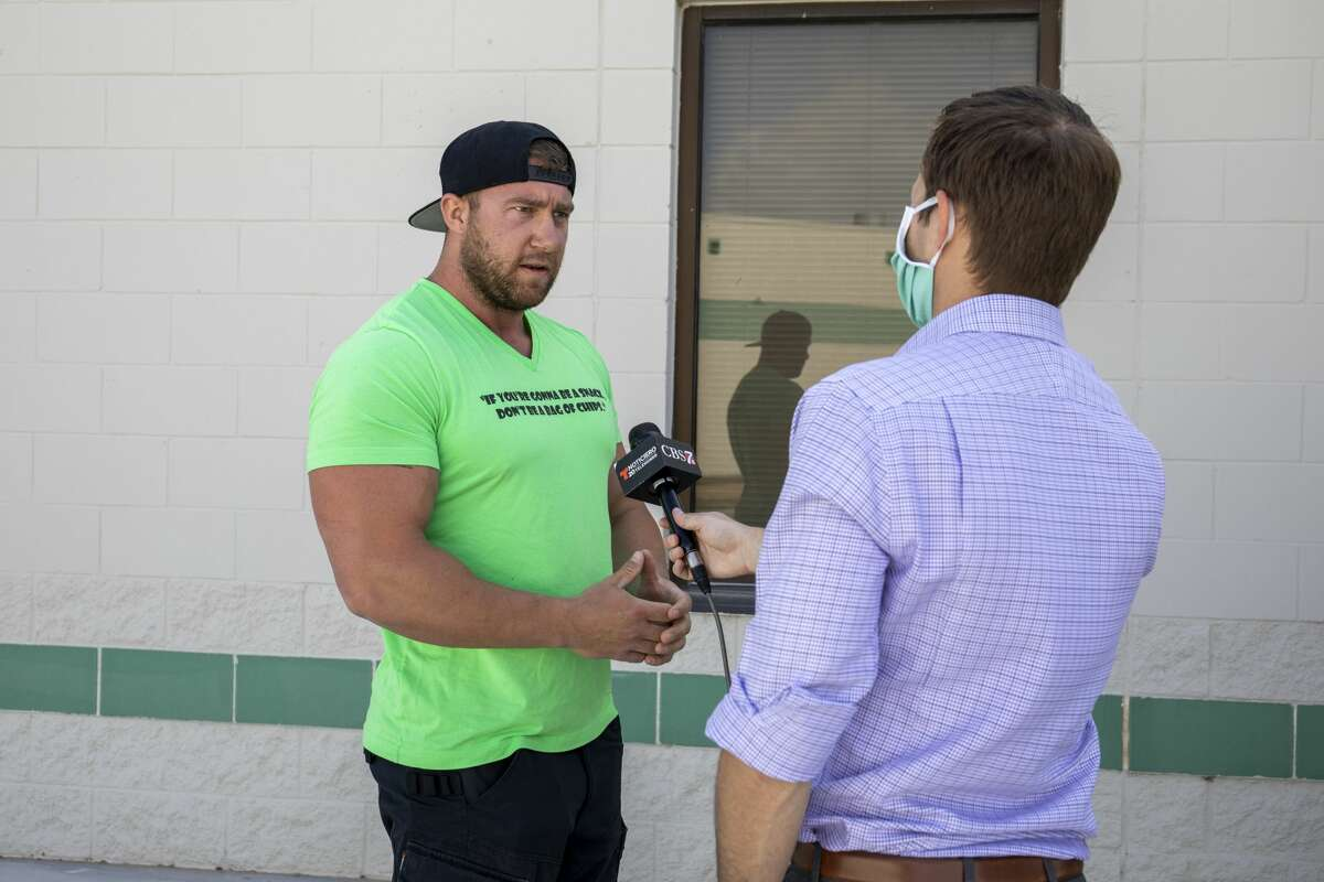 Open Texas member and personal trainer Philip Archibald, from Plano, takes to a KOSA-TV anchor on Tuesday, May 5, 2020 outside the Ector County Sheriff?•s Office. Jacy Lewis/Reporter-Telegram