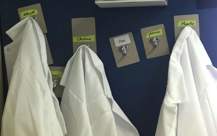 Lab coats of scientists hanging at a Portola Pharmaceuticals lab in San Francisco, Calif. Photo: File / ONLINE_YES