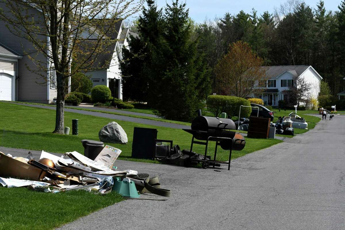 Piles of bulk trash await collection in front of Aster Drive homes on Tuesday, May, 5, 2020, in Clifton Park, N.Y. Malta is only allowing large trash drop off in June 2021, after problems with people from other towns leaving trash on the sides of roads before haul away day. (Will Waldron/Times Union)