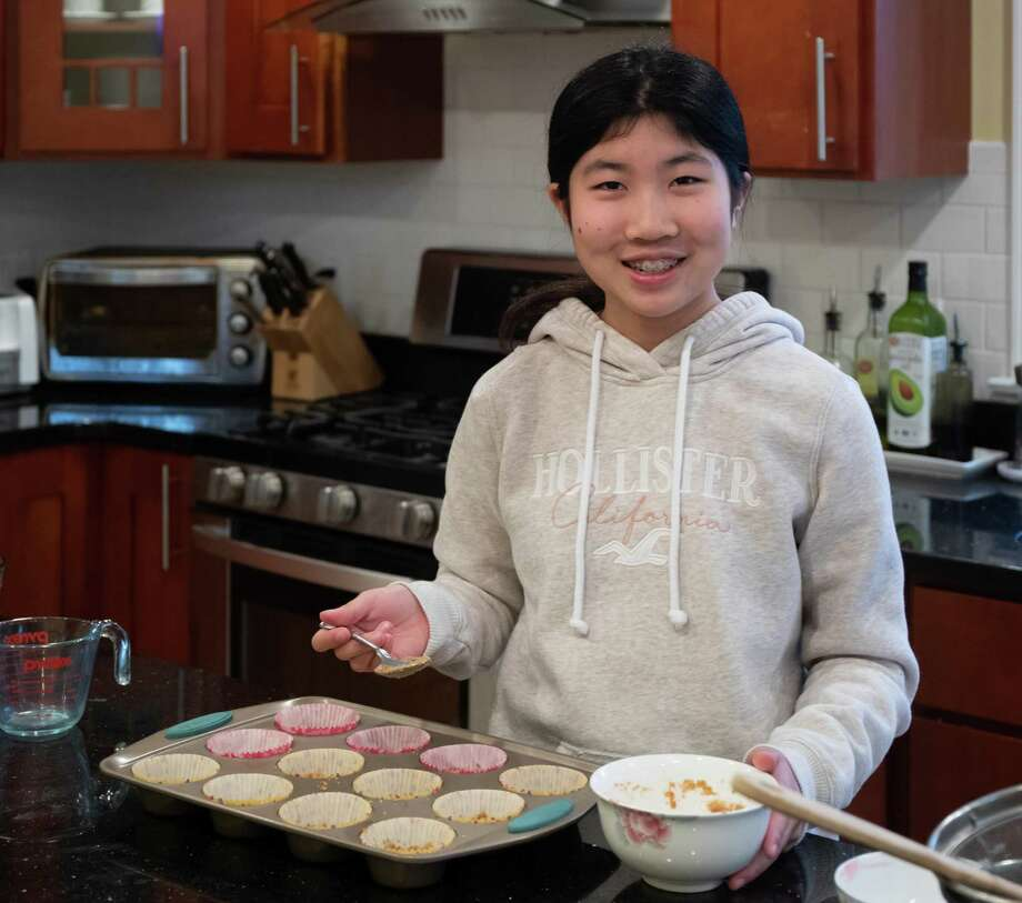 Annabelle Zheng, a seventh grader at Middlebrook School, bakes mini raspberry cheesecakes at home in Wilton, Ct. May 2020 Photo: Contributed Photo / Wilton Bulletin Contributed