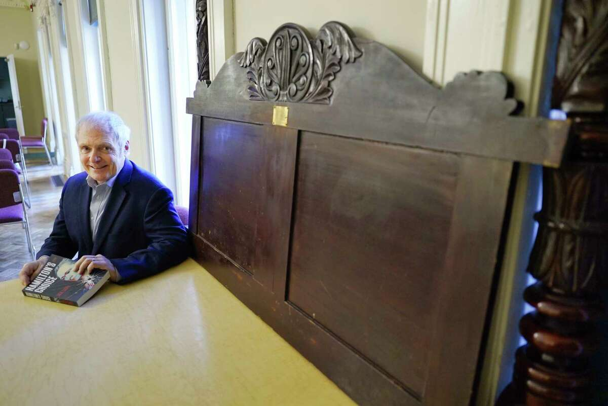 Jack Casey, the author of Hamilton's Choice, poses next to Aaron Burr's bed headboard and posts at The Hart Cluett Museum on Tuesday, May 5, 2020, in Troy, N.Y. Hamilton was killed in a duel with Aaron Burr. (Paul Buckowski/Times Union)