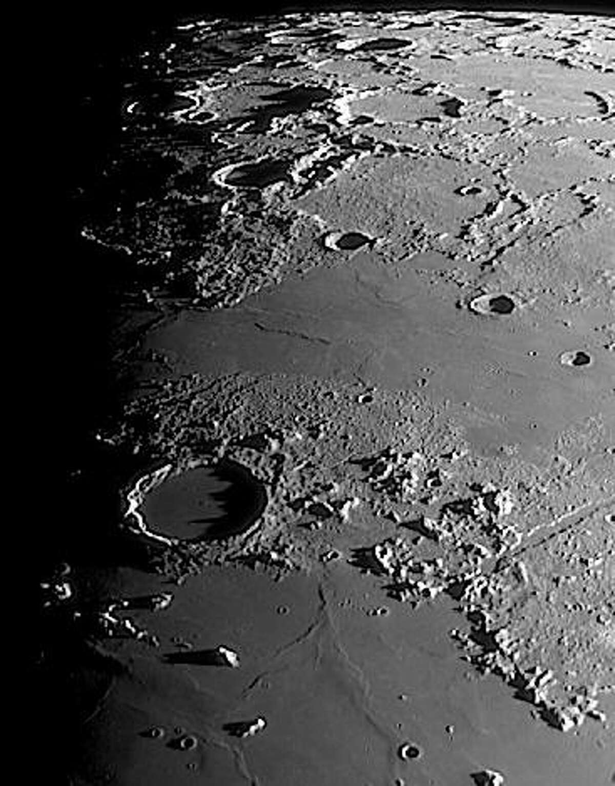 Images and videos of calm and serene scenes are being shared throughout the media and online during these stressful times. Bill Cloutier of the John J. McCarthy Observatory in New Milford captured this scene of a quiet corner of the moon April 1.The image features the crater Plato - named after ancient Greek philosopher Plato - located on the northern shore of the Mare Imbrium and at the western reach of the lunar Alpes. The crater is approximately 63 miles across, 4,800 feet in depth, with its floor flooded by an ancient lava flow. About 3.84 billion years old (slightly younger than the adjacent mare to the south), its jagged rims casts menacing shadows across the crater floor at sunrise. For those who are interested in learning more about Plato or other lunar features, contact the observatory at mccarthy.observatory@gmail.com to set up a possible webcast or informal observatory chat.